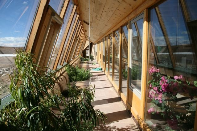Earthship green homes life without bills for Eco homes canada